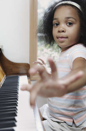 children's wear: Young girl playing the piano