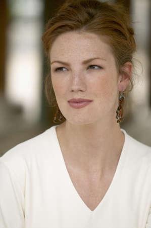looking sideways: Young woman looking sideways