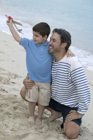 Young man with a young boy on the beach Stock Photo - 16043658