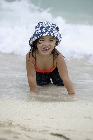 Young girl lying on the beach