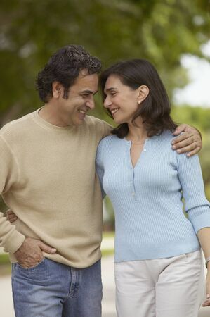 two persons only: Mid adult couple standing close to each other