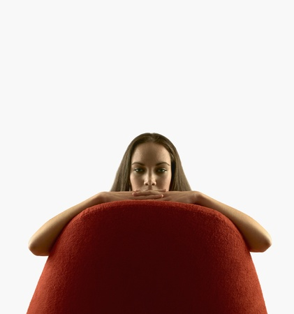 davenport: Portrait of a young woman sitting on a sofa LANG_EVOIMAGES