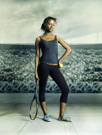 way of behaving: Young woman standing holding a tennis racket and a tennis ball LANG_EVOIMAGES