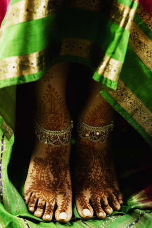 Woman's feet with henna and ankle bracelets Stock Photo - 16043716