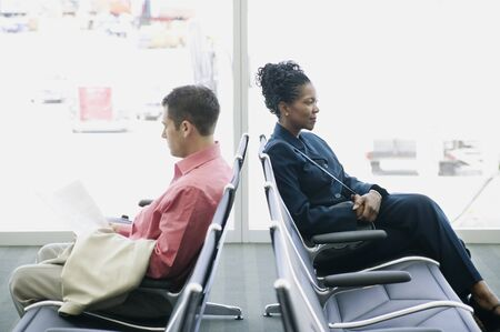 savvy: Side profile of a man and a woman sitting in an airport lounge