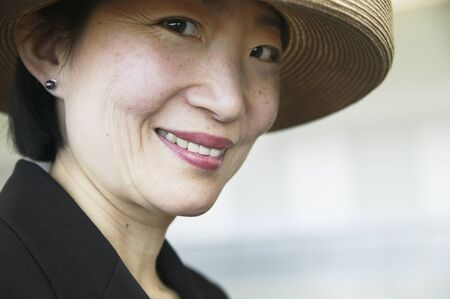 Close-up of a businesswoman wearing a hat Stock Photo