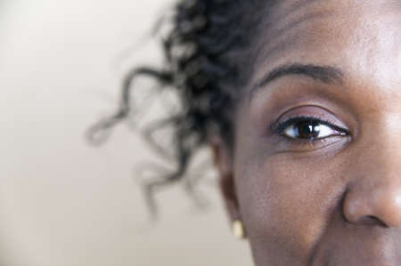 close up: Portrait of a mid adult woman looking at camera