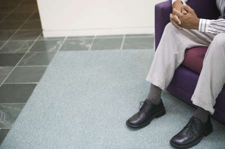 Businessman sitting on a couch Stock Photo - 16043890