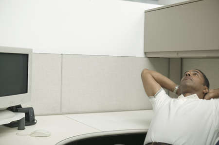 restfulness: Businessman sitting on a chair leaning back with his hands on his head