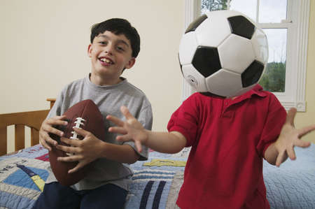 two persons only: Portrait of a boy playing with a football