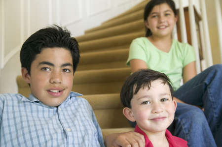 three persons only: Portrait of children sitting on stairs LANG_EVOIMAGES