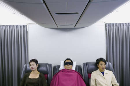 Passengers sleeping in an airplane Stock Photo - 16044140