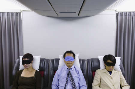Passengers sleeping in an airplane Stock Photo - 16044141