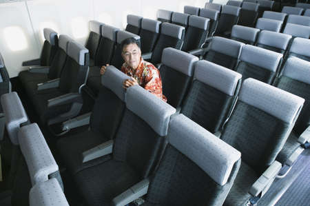 hydroplane: High angle view of a mature man traveling in an empty airplane LANG_EVOIMAGES