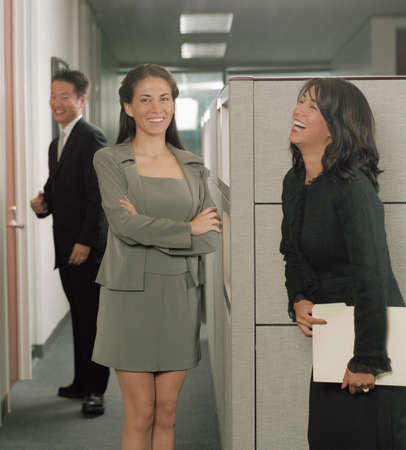 three persons only: Young women talking in office