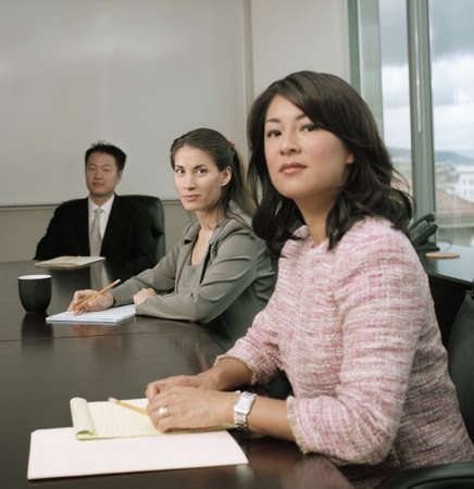 Three young people sitting in a meeting Stock Photo - 16044178
