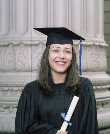 Young female graduate standing holding a diploma