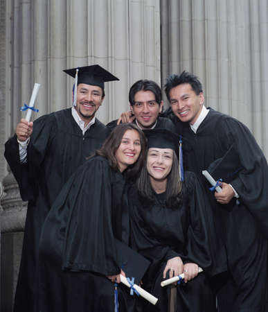 Group of young graduates standing together outdoors Stock Photo - 16044190