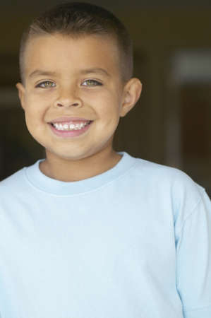 young boy smiling: Portrait of a young boy smiling