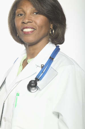 mid adult female: Portrait of mid adult female doctor standing with a stethoscope around her neck