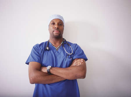 effrontery: Portrait of a male doctor wearing scrubs LANG_EVOIMAGES