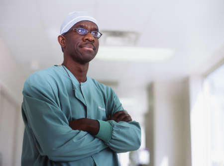 effrontery: Portrait of a male doctor standing with arms folded