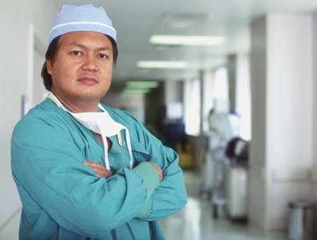 Male doctor standing in a hospital corridor Stock Photo - 16044326