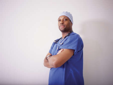 credence: Portrait of a male nurse standing with arms folded LANG_EVOIMAGES