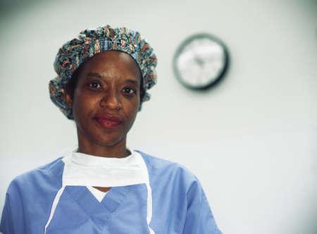 largesse: Portrait of a female nurse wearing full scrubs