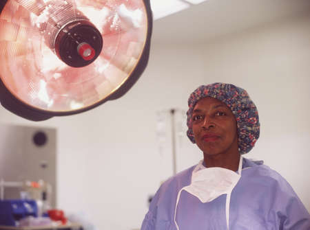 largesse: Female nurse in an operating theatre
