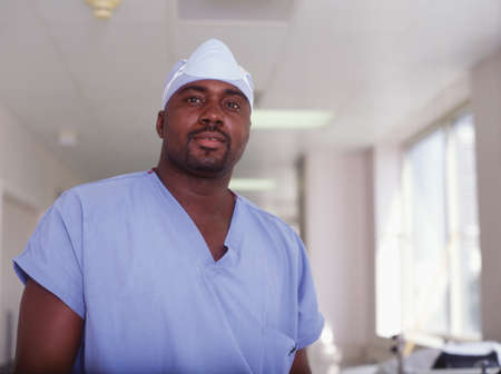Male surgeon standing in a hospital corridor Stock Photo - 16044348