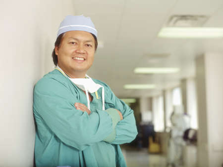 Male doctor standing in a hospital corridor Stock Photo - 16044349