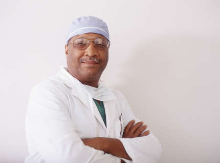 effrontery: Portrait of a male surgeon standing with arms folded