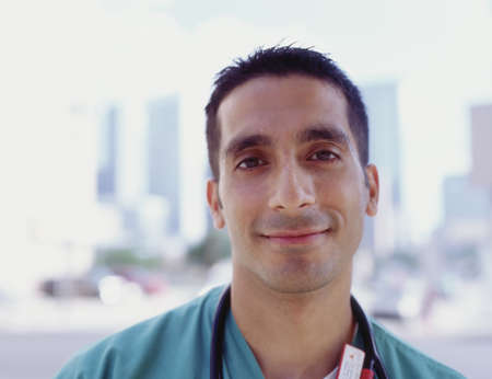 effrontery: Portrait of a male doctor smiling