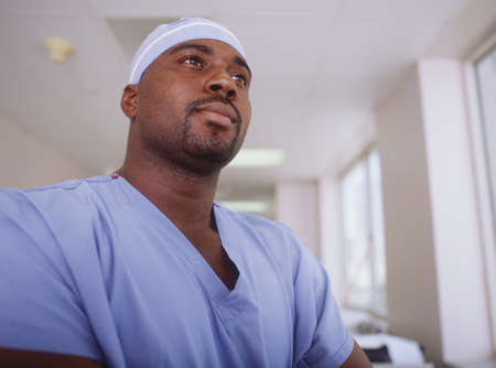 way of behaving: Low angle view of a male surgeon in a hospital corridor
