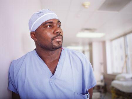 way of behaving: Male doctor in full scrubs