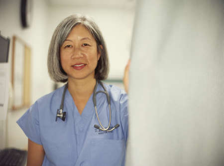asian doctor: Portrait of a female doctor standing in a hospital room