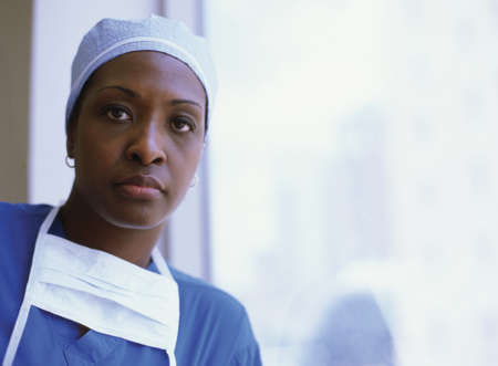 panache: Portrait of a female wearing full scrubs LANG_EVOIMAGES