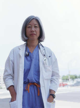 effrontery: Portrait of a female surgeon standing outdoors