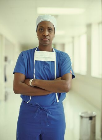 panache: Portrait of a female nurse wearing surgical scrubs standing in a hospital corridor LANG_EVOIMAGES