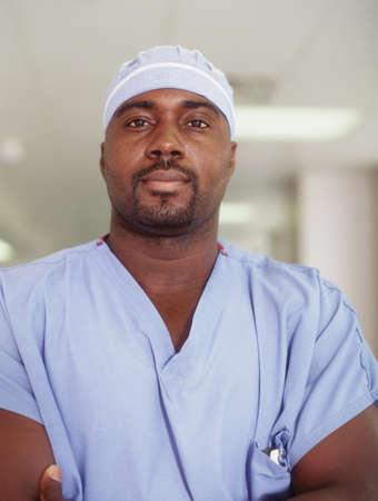 A Hospital Orderly In A Hospital Corridor Stock Photo Picture And