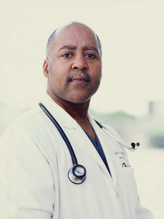 effrontery: Portrait of a male doctor with a stethoscope around his neck