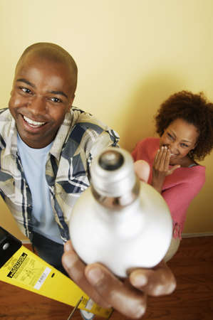 ebullient: Young couple holding a light bulb