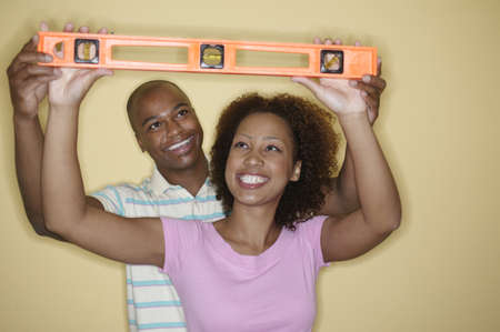 ebullient: Young couple holding a spirit level