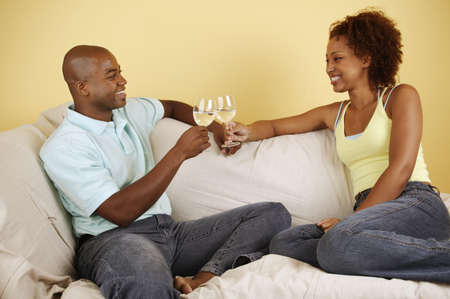 Young couple toasting with wine glasses Stock Photo - 16044453