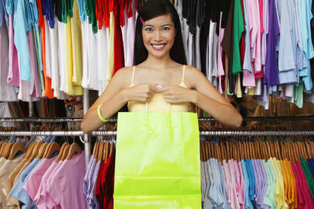 Portrait of a young woman standing in a department store Stock Photo - 16044473
