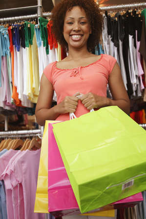 Low angle view of a young woman holding shopping bags in a department store Stock Photo - 16044474