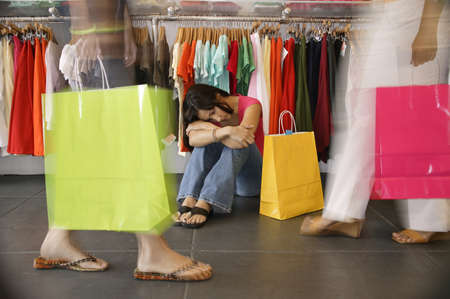 Three young women at a department store Stock Photo - 16044479