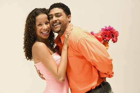 spanish ethnicity: Young couple standing together looking at camera smiling