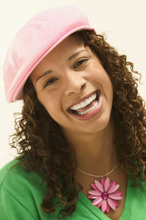 spanish ethnicity: Young woman looking at camera smiling